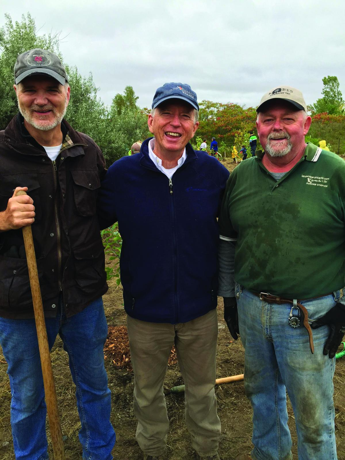 Mark Cullen, (centre) Board Chair of the Living Tribute, joined by cousin Bruce Cullen (left), recently retired as head groundskeeper of the Metro Toronto Zoo, and Norm Mills (right), President of Landscape Ontario's Durham Chapter.