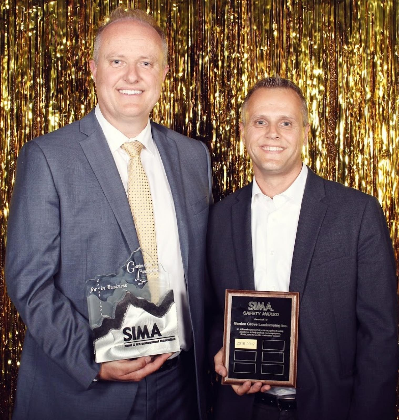 David Lammers (left) with the Excellence in Business Award, joined by his brother Paul Lammers, with the Safety Award.