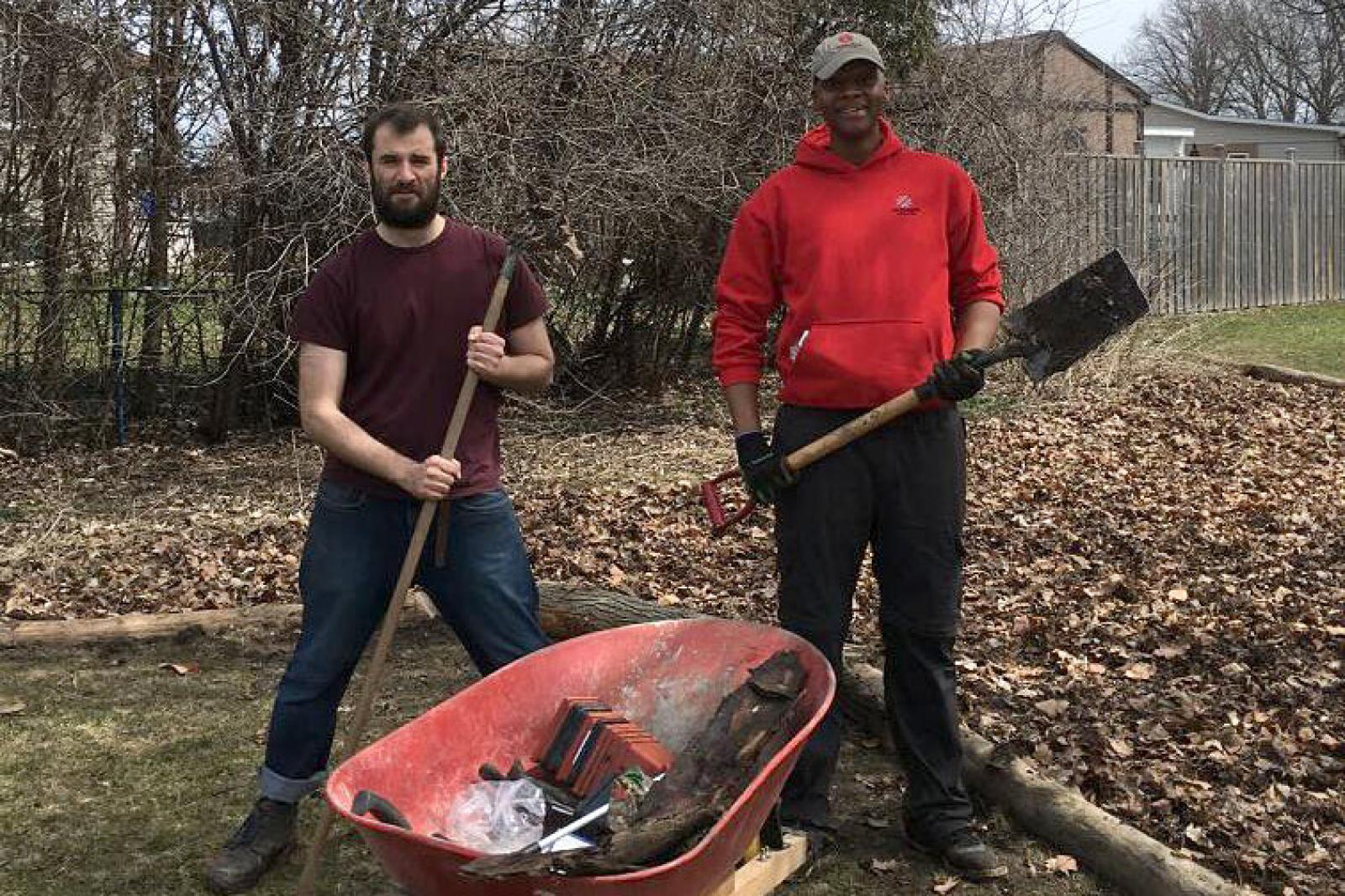 Fanshawe Colleges students, Geoffrey Trenholm Tobias Edwards and Lisa Norton (below) help with the clean up of the park.