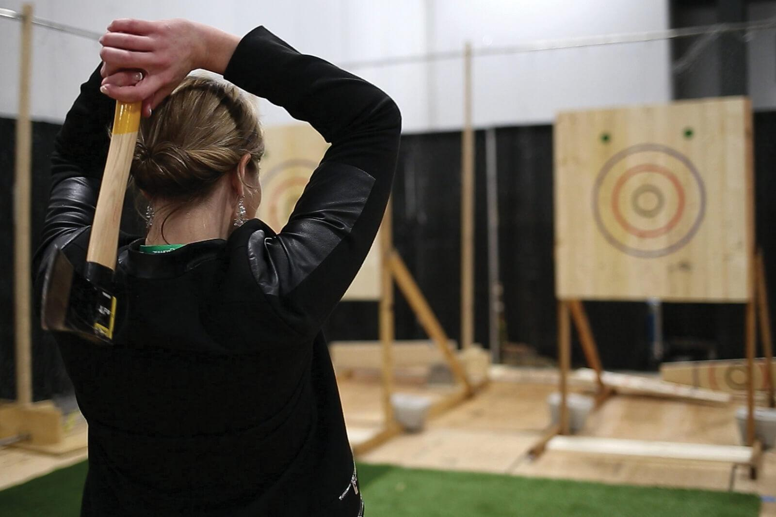 The axe throwing competition was one of four contests added to the GreenTrade Expo show floor this year.