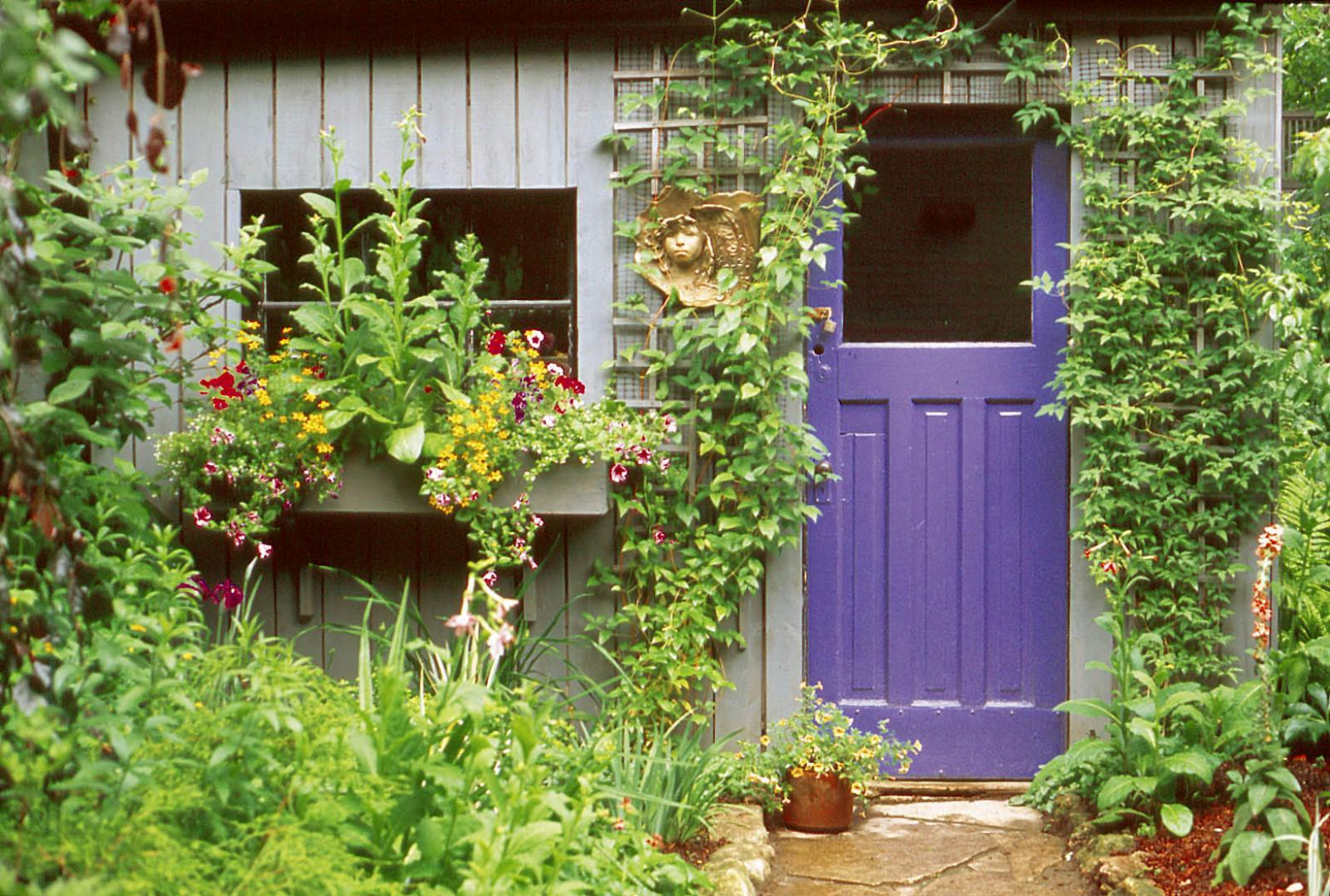 A gardener sensitive to blue's accent power painted this door.