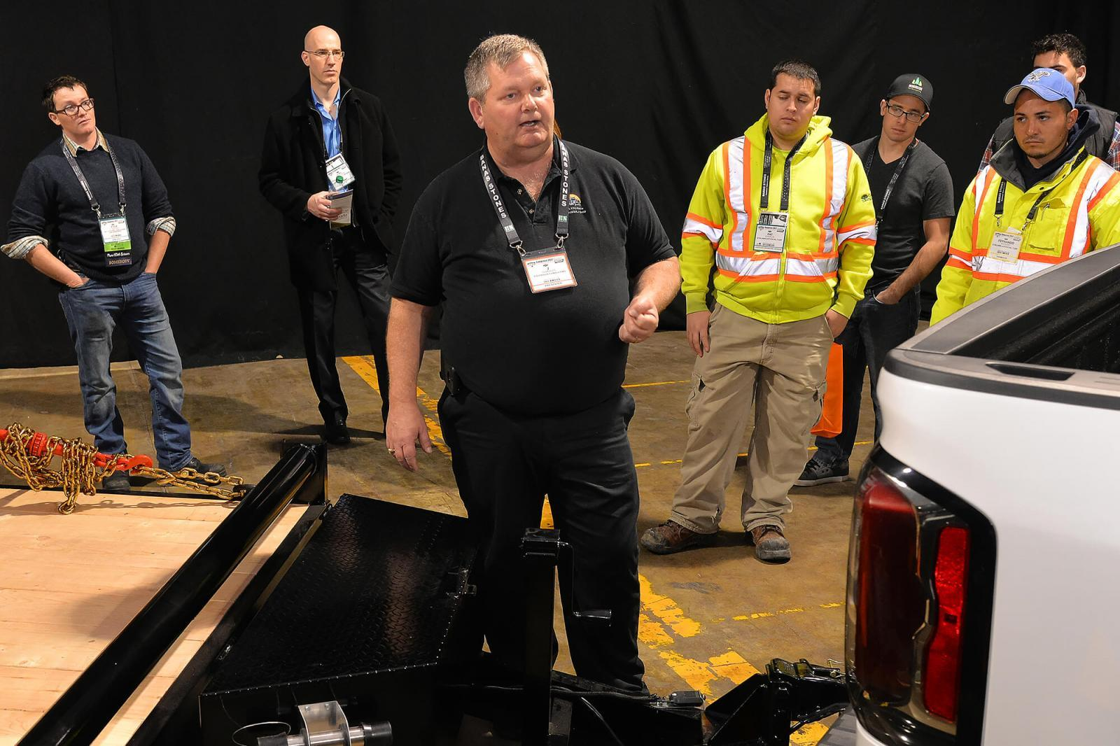 Trade show attendees learn proper vehicle safety on the show floor at Congress.