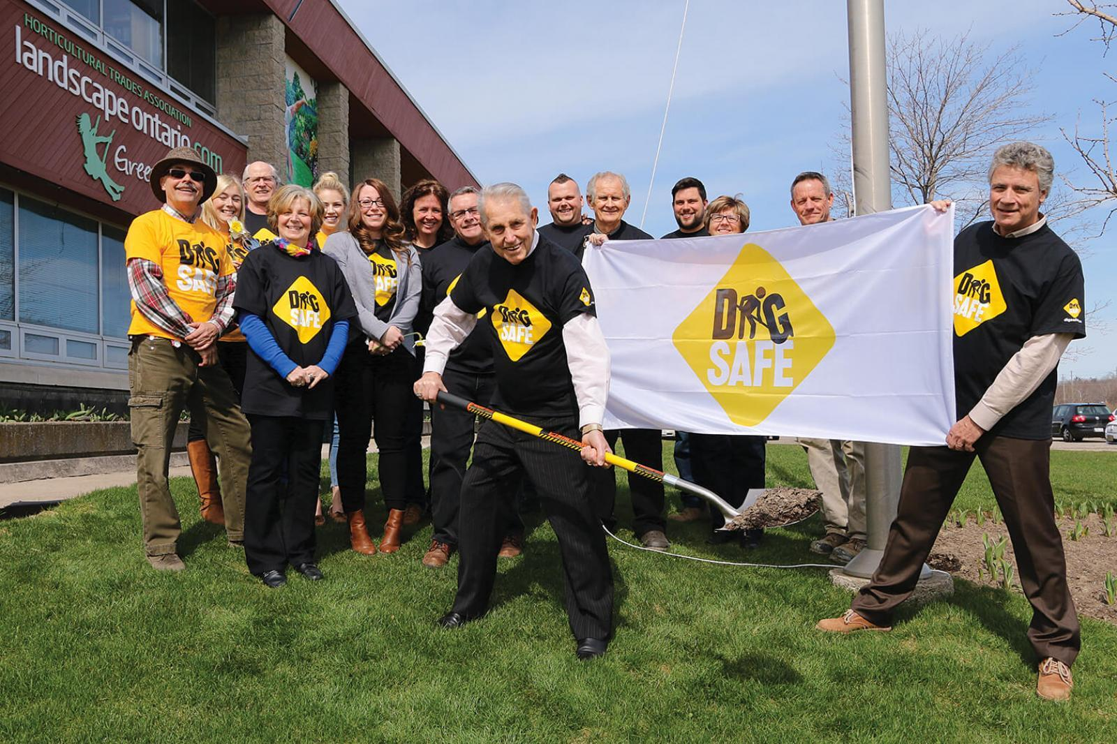 A Dig Safe flag was raised at the LO home office in Milton to promote April as Dig Safe Month.