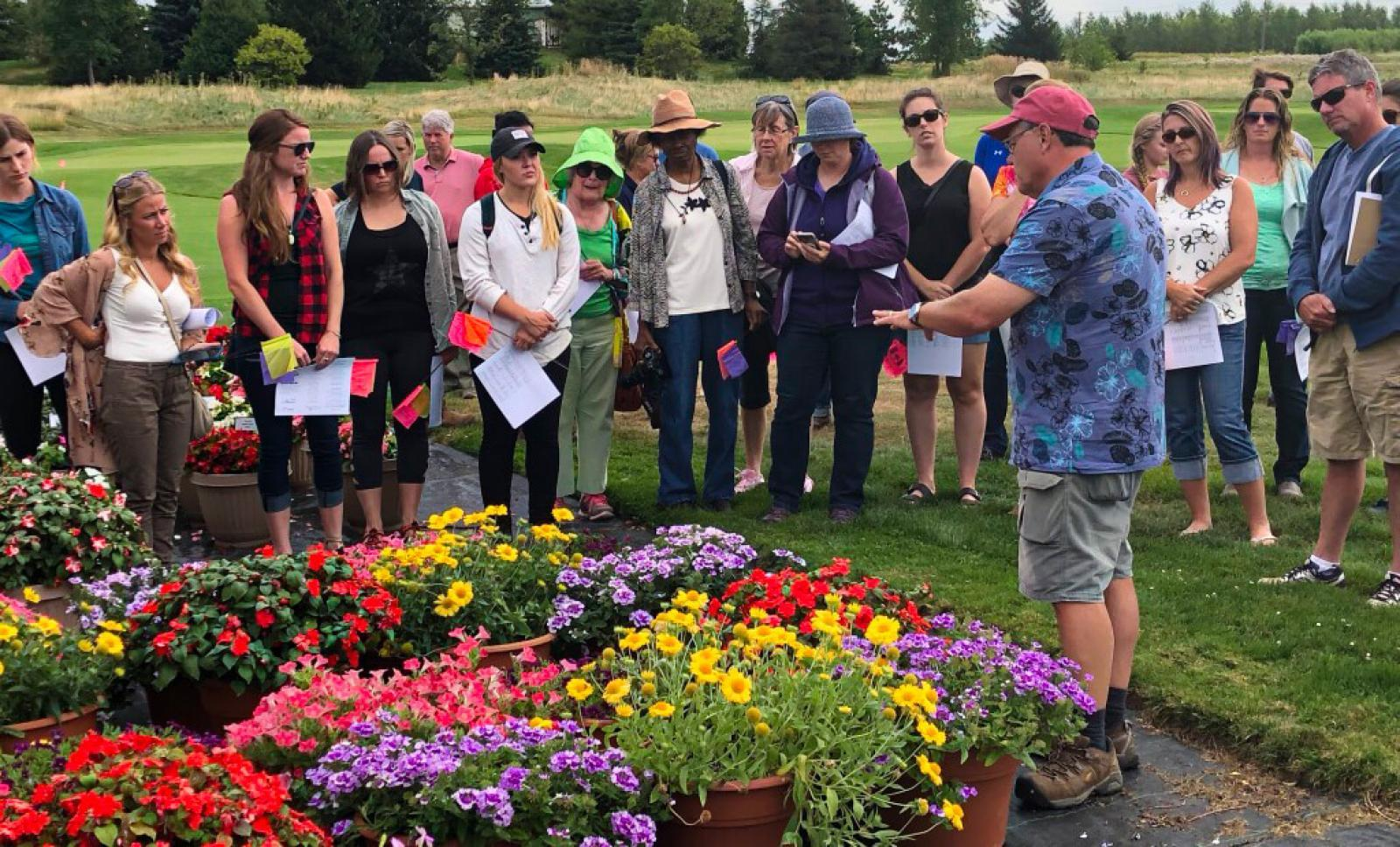 Trial Garden Manager Rodger Tschanz, leads a tour of the Guelph site at this year's open house.