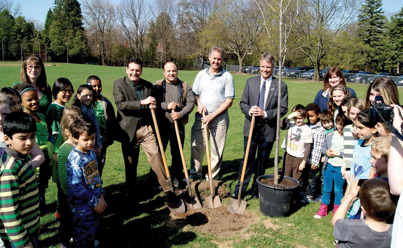 The Golden Horseshoe Chapter's move to build community relationships was popular with the students at King's Road Elementary School in Burlington. The Chapter organized a tree planting day as part of Arbor Day. In photo Chapter board members Fiore Zenone and Tim Cruickshanks are joined by the students and staff of the school along with Burlington mayor Rick Goldring and councillor Rick Craven.