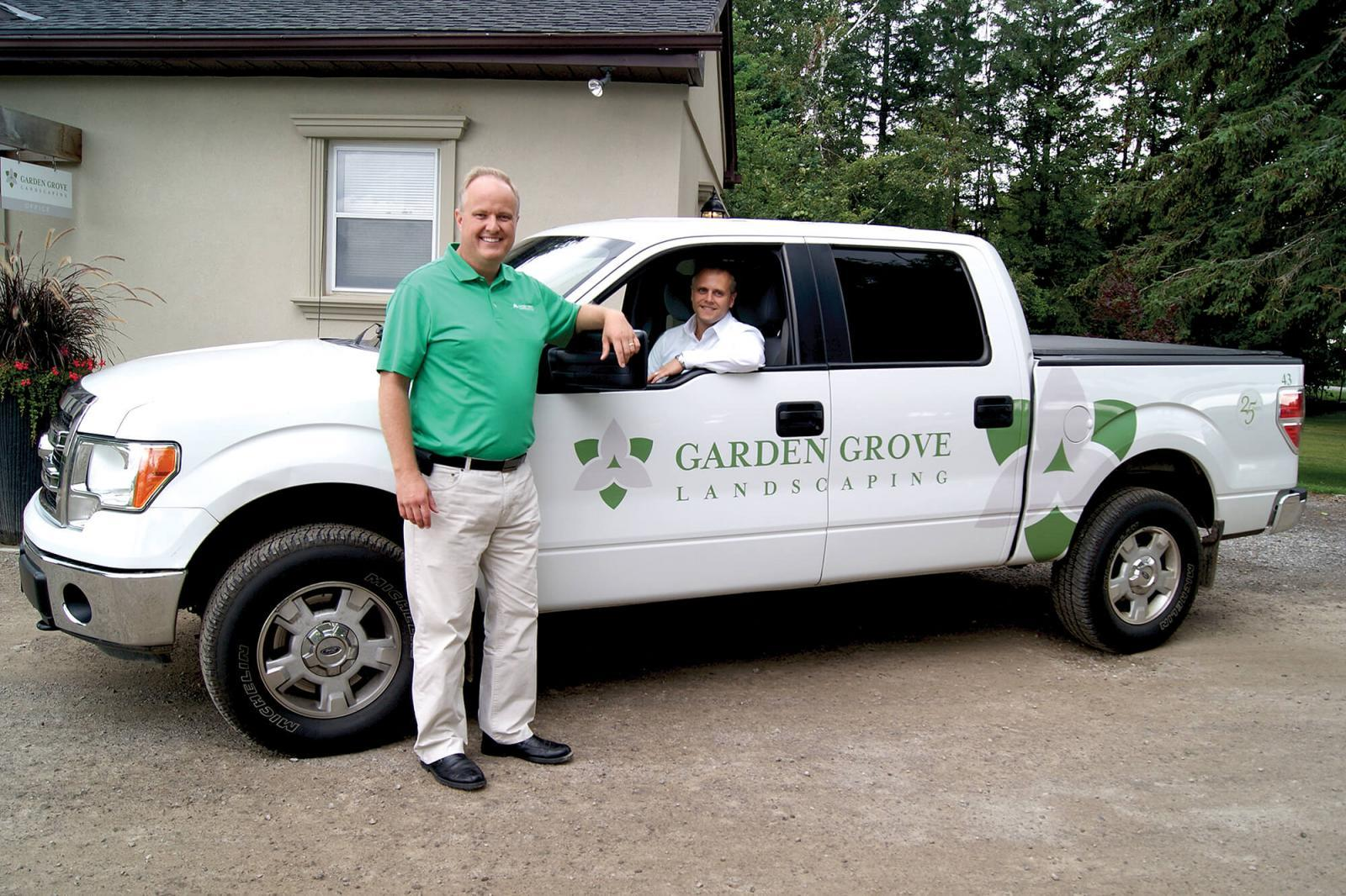 David Lammers, standing, and his brother Paul are celebrating 25 years of success operating their business, Garden Grove Landscaping in Waterdown.