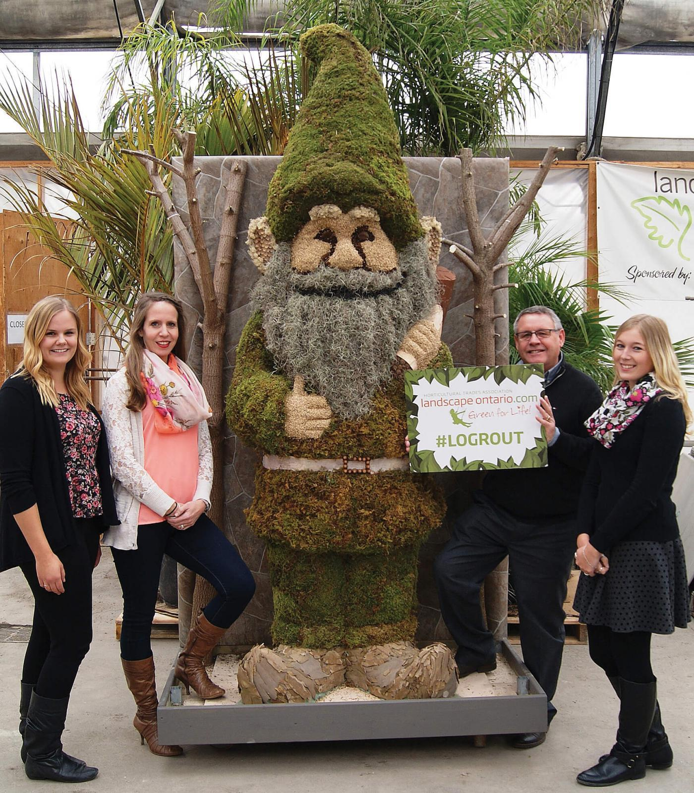 Grout the giant gnome is ready for a starring role in 2016 with his team of LO membership department staff, from left, Cassandra Wiesner, Rachel Cerelli, Denis Flanagan and Myscha Burton.