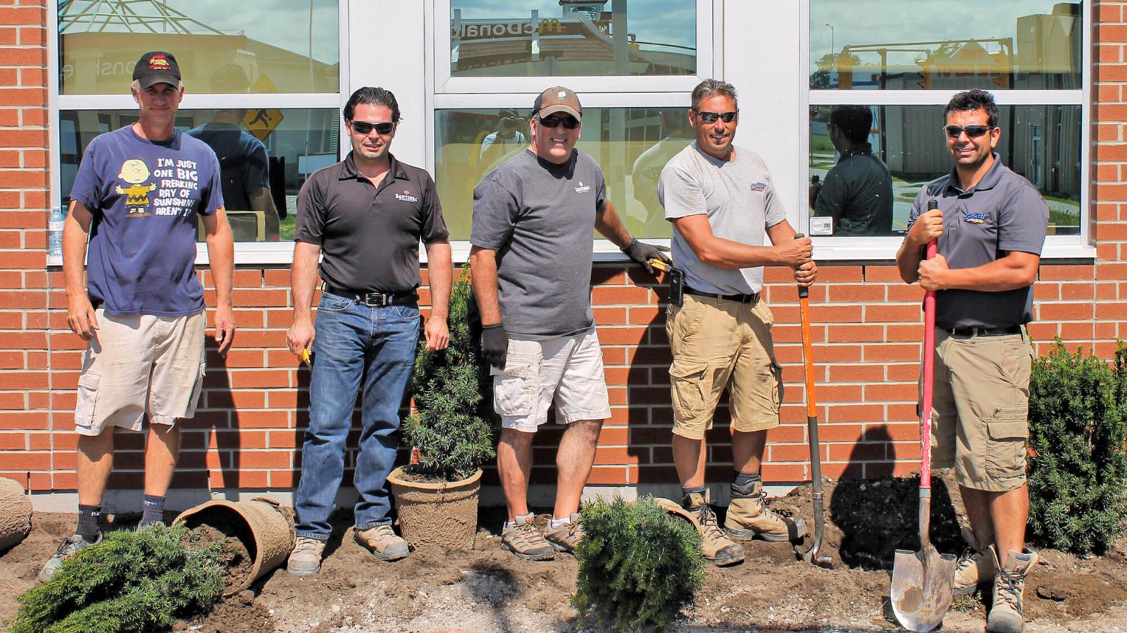 Members of Windsor Chapter lent their creative talents to improve the Safety Village of Windsor. In photo, from left, are some of those members, Dan Garlatti, Joe Santarossa Jr., Chris Power, Darren O'Grady and Sal Costante.
