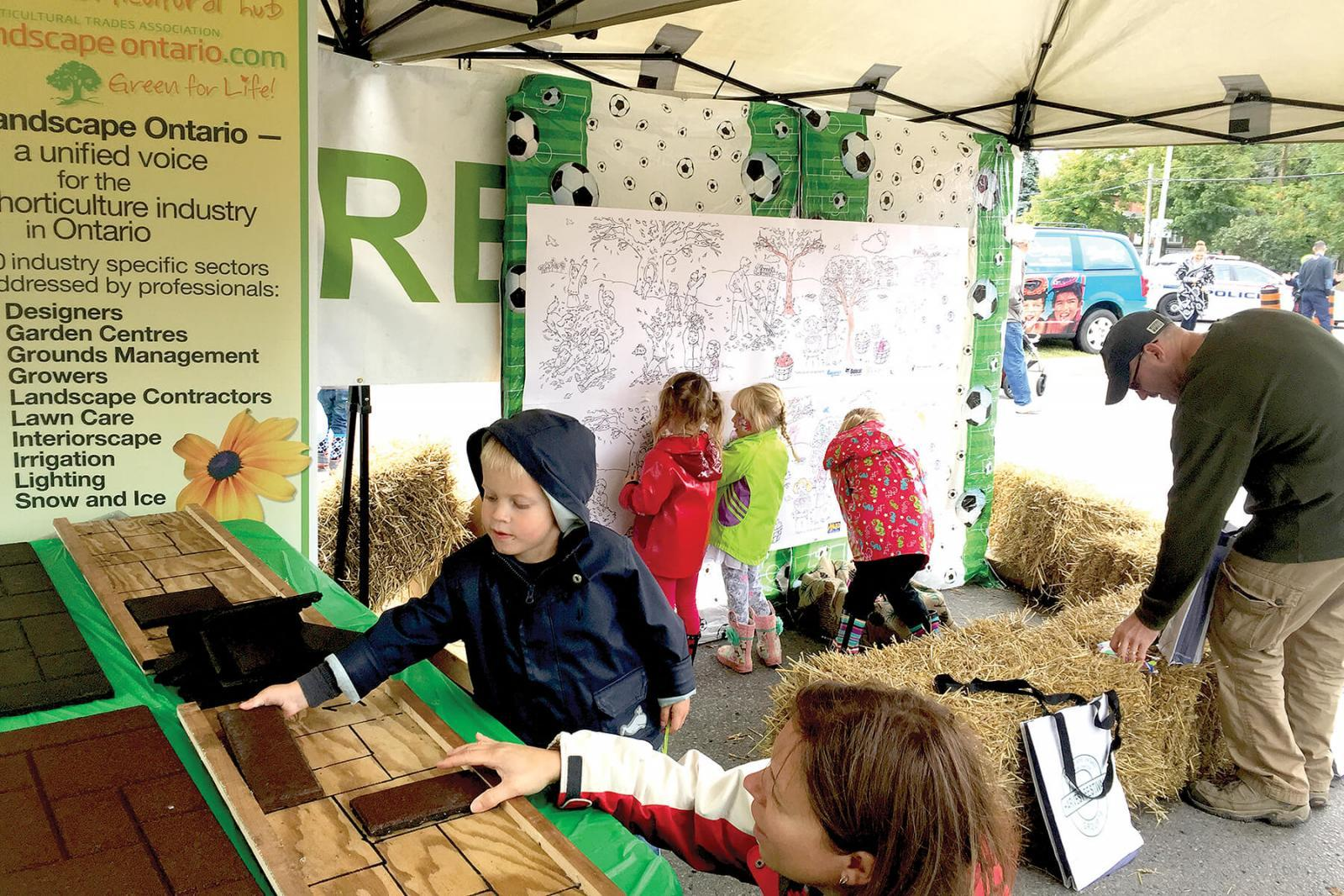 A giant colouring board and wood carvings attracted a great deal of attention to the Landscape Ontario Durham Chapter display at the Brooklin/Whitby Harvest Festival.