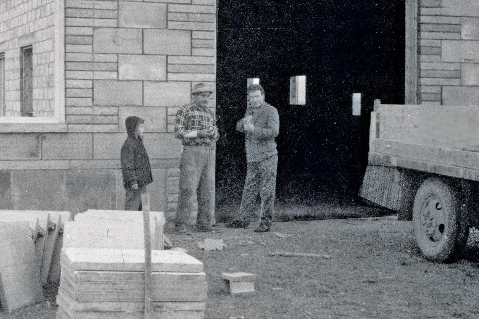 Back in 1962, before the formation of Best Way Stone, Angelo Pignatelli (wearing hat), and his son Paolo (at truck door) were busy installing patios.