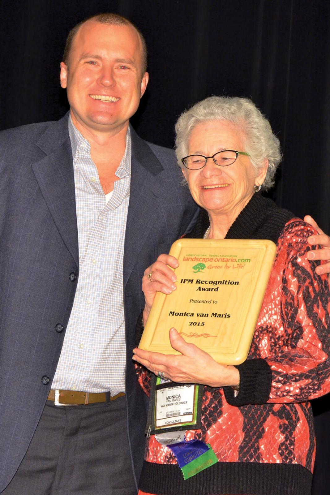 Monica van Maris, a pioneer member of Landscape Ontario and annual volunteer at Congress, was presented with a Leadership Award at the 50th IPM Symposium. She is shown accepting the award from Kyle Tobin, chair of the IPM Symposium Committee.