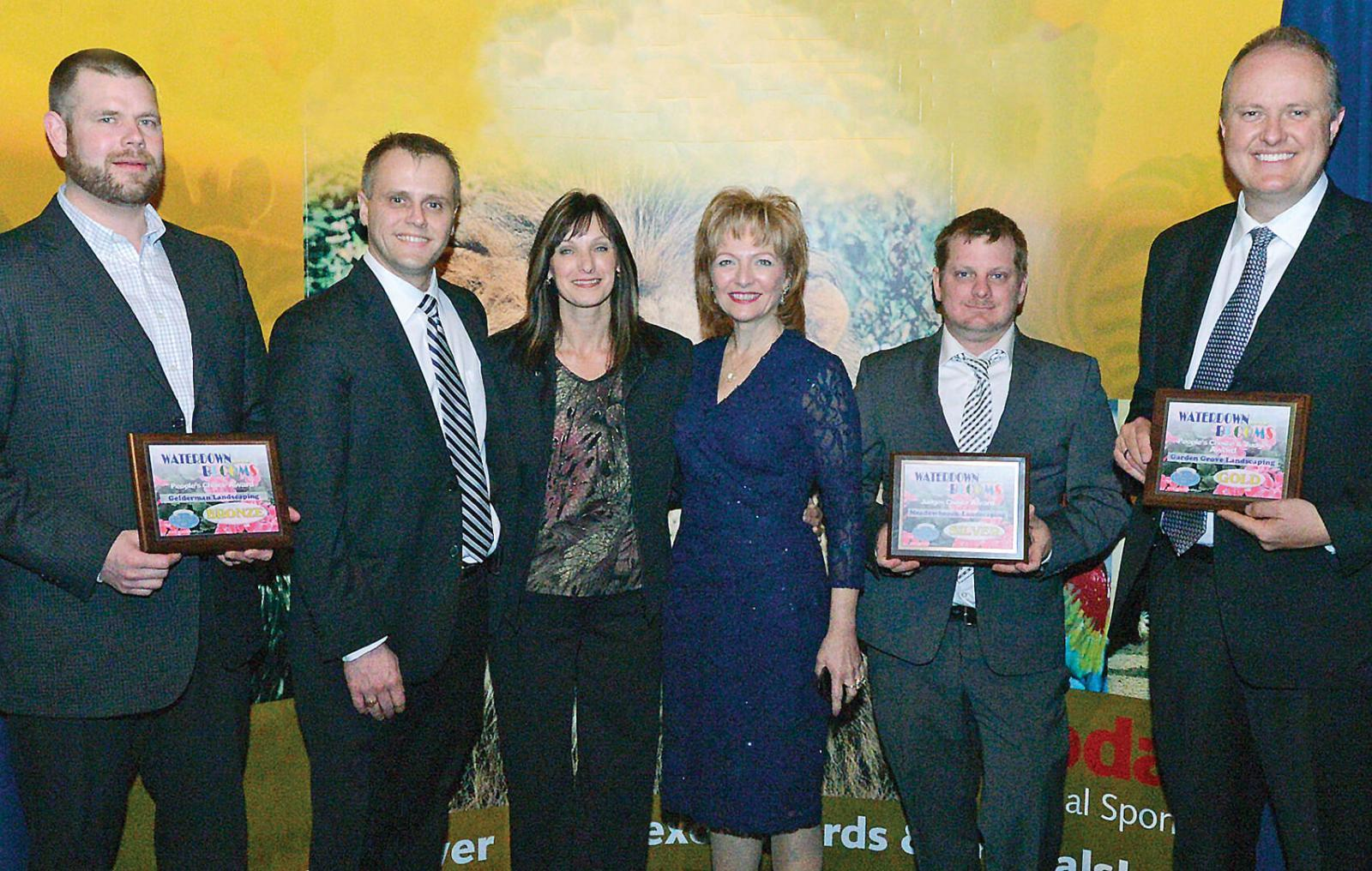 Accepting their awards from the Waterdown BIA, from left, Nathan Helder, Gelderman Landscaping; Paul Lammers, Garden Grove Landscaping; Lee Rozon; Judi Partridge,Ward 15 Councillor; Tim Rivard, accepting for Meadowbrook Landscaping; David Lammers, Garden Grove Landscaping.
