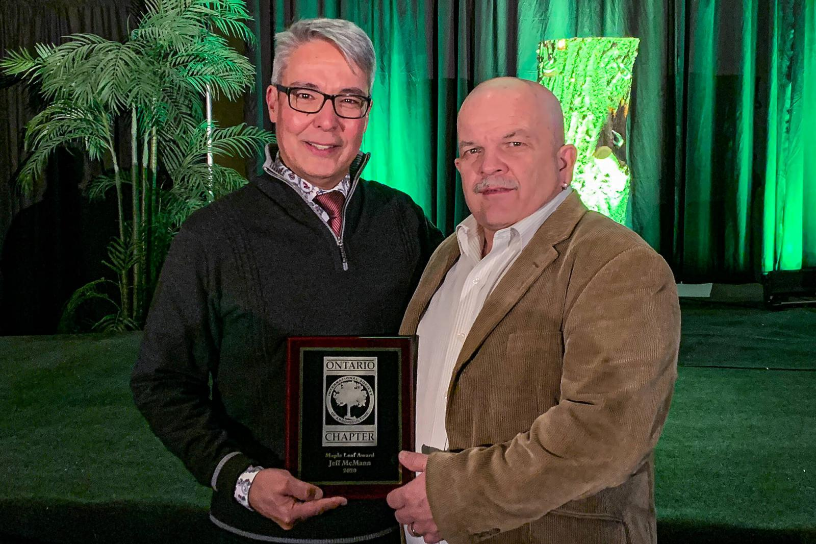 Jeff McMann (left) accepts his award from John Stewart, Past President, ISA Ontario.