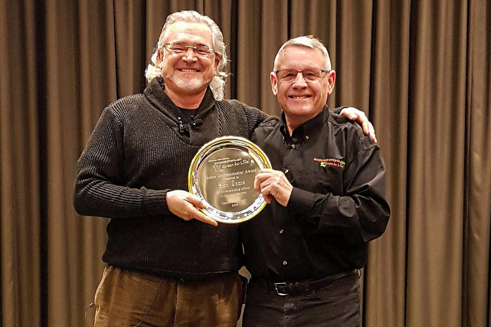 Landscape Ontario's Denis Flanagan (right) caught up with Sean James, owner of Sean James Consulting & Design, at the London Plant Symposium to present him with the 2020 Garden Communicator's Award.