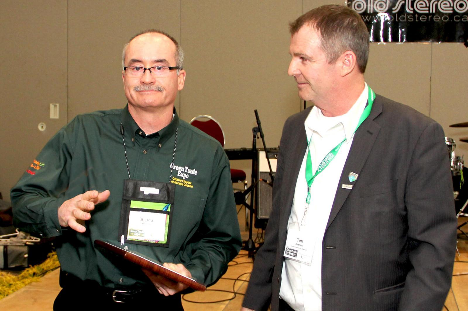 Bruce Morton of Greenscape Water Systems, left, received the distinguished member award from Tim Kearney of Garden Creations.The award was presented to honour Morton's dedication towards GreenTrade over the show's 20-year history.