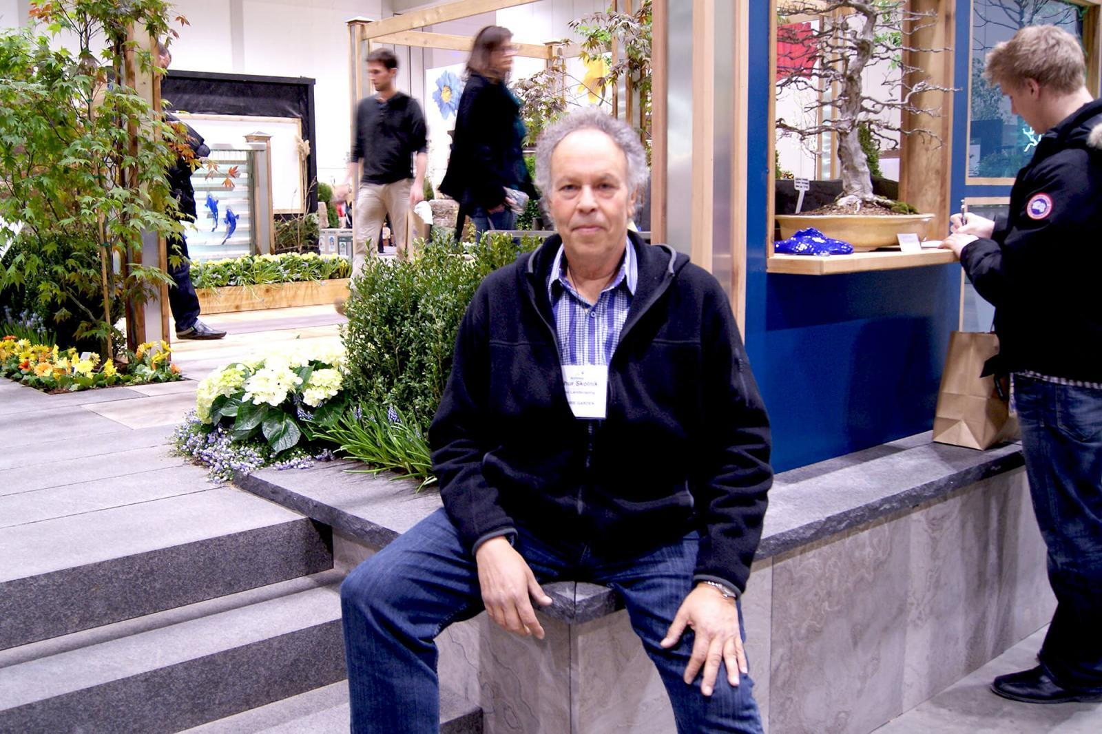 Arthur Skolnik of Shibui Landscaping Toronto poses with his garden, which received a number of awards at Canada Blooms.