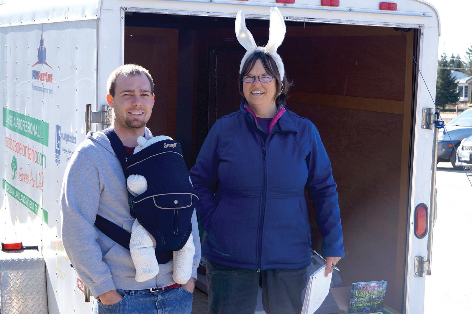Lynne Barnes of Gordon J Leece Landscapes, Thornbury, is joined by an area resident after he donated food to the Chapter's food drive in Barrie.