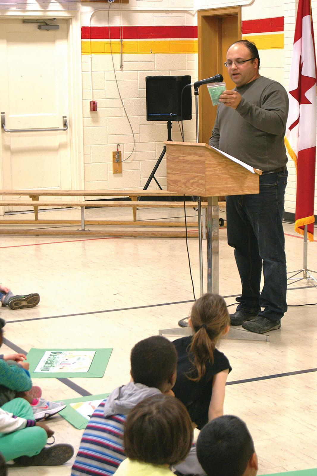 Golden Horseshoe president Fiore Zenone explains to students that each of them will receive a package of tree seeds to take home.