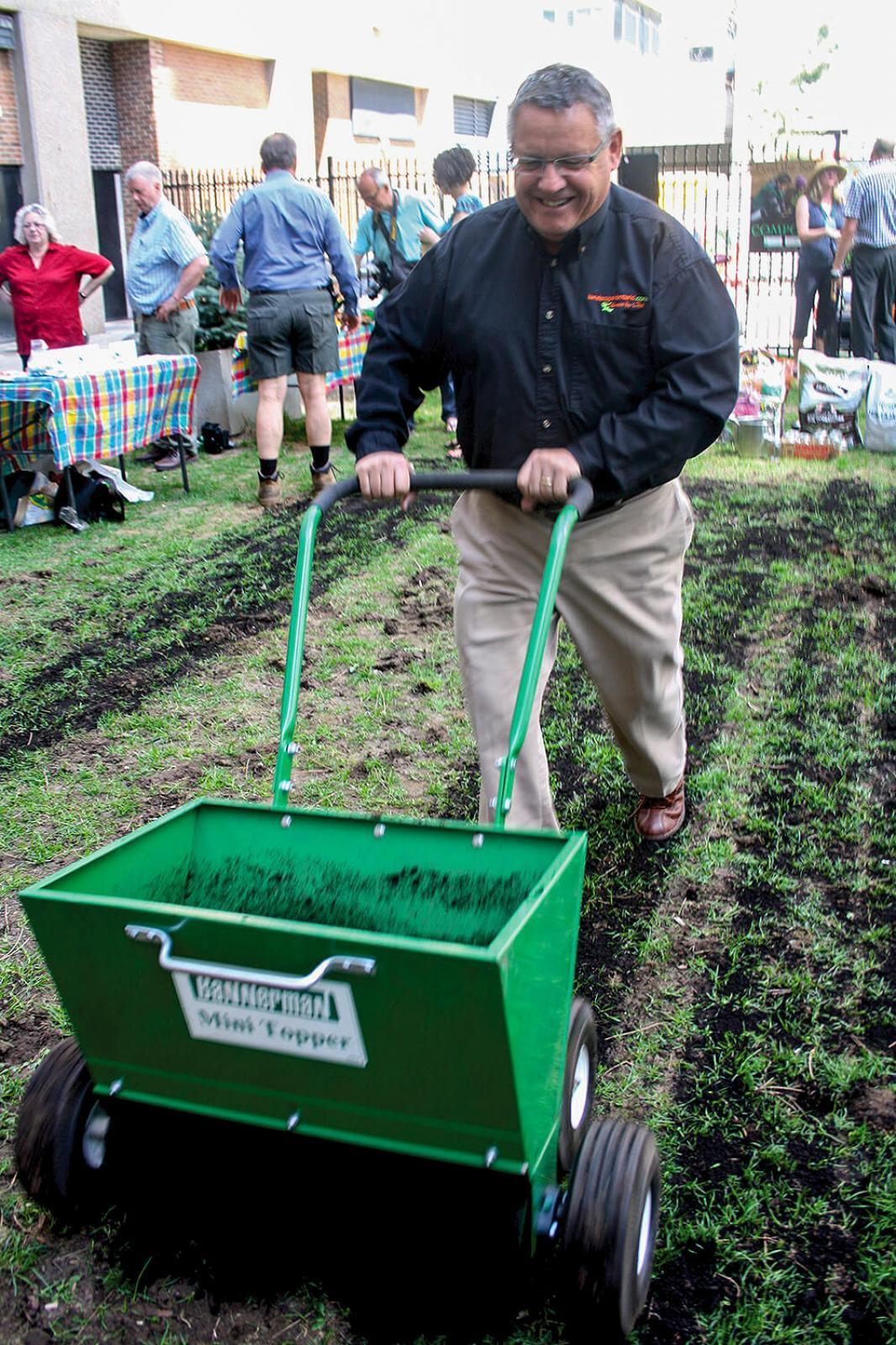 LO's public relations director Denis Flanagan proved he is not just another pretty face, when he took on the task improving the soil at Compost Awareness Week at a site in downtown Toronto.