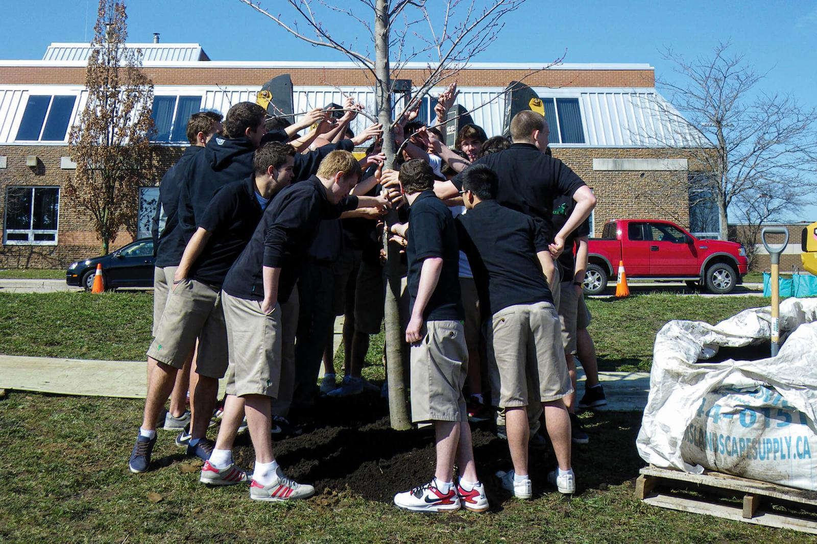 Chapter plants tree in memory of member's son