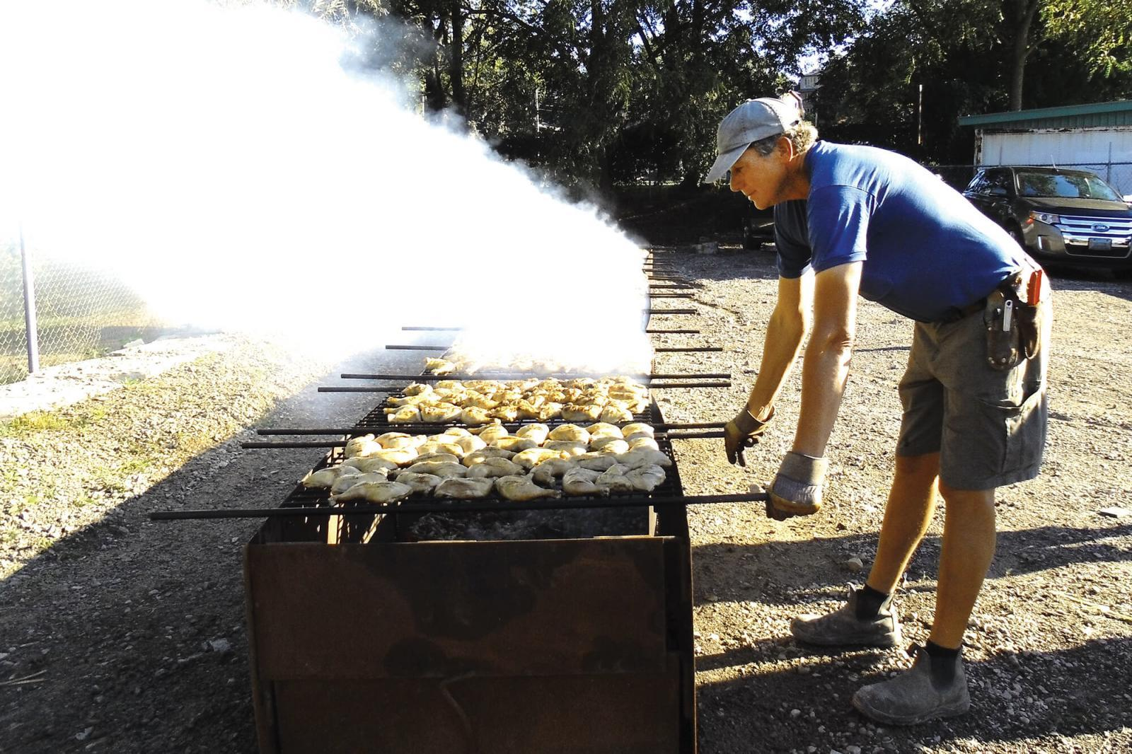 Paul DeGroot continues his annual task of barbecuing hundreds of chickens.