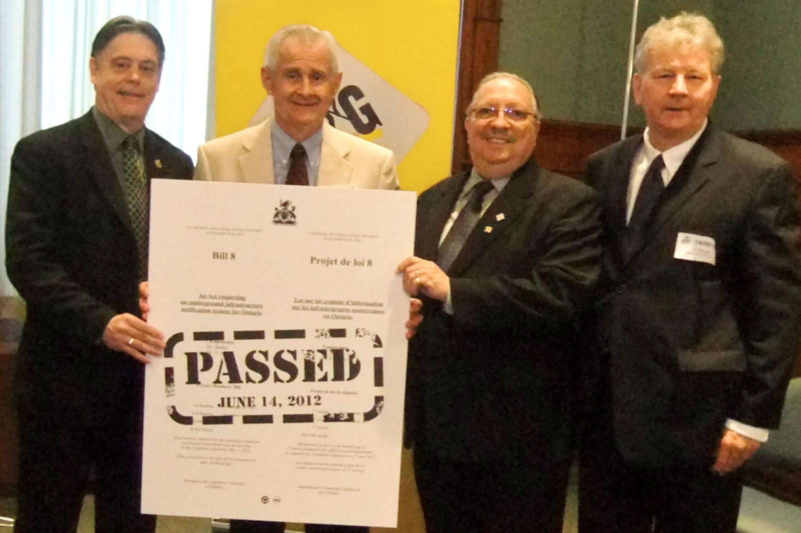 Celebrating the passage of Bill 8 at Queen's Park, June 14, are from left MPP Bob Bailey, co-sponsor of Bill 8, ORCGA board of directors member Terry Murphy, who represents the landscape industry, and LO, MPP Paul Miller, co-sponsor of Bill 8, and ORCGA president Jim  Douglas.