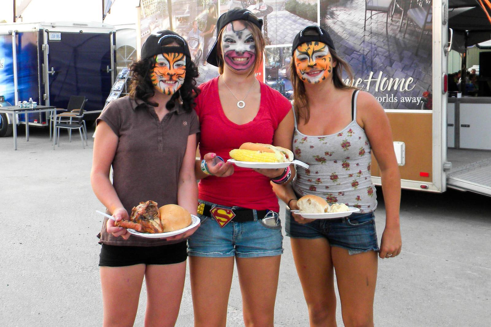 These girls had fun at the face-painting booth, at the Golden Horseshoe Chapter Chicken Roast  before grabbing great chicken and corn.