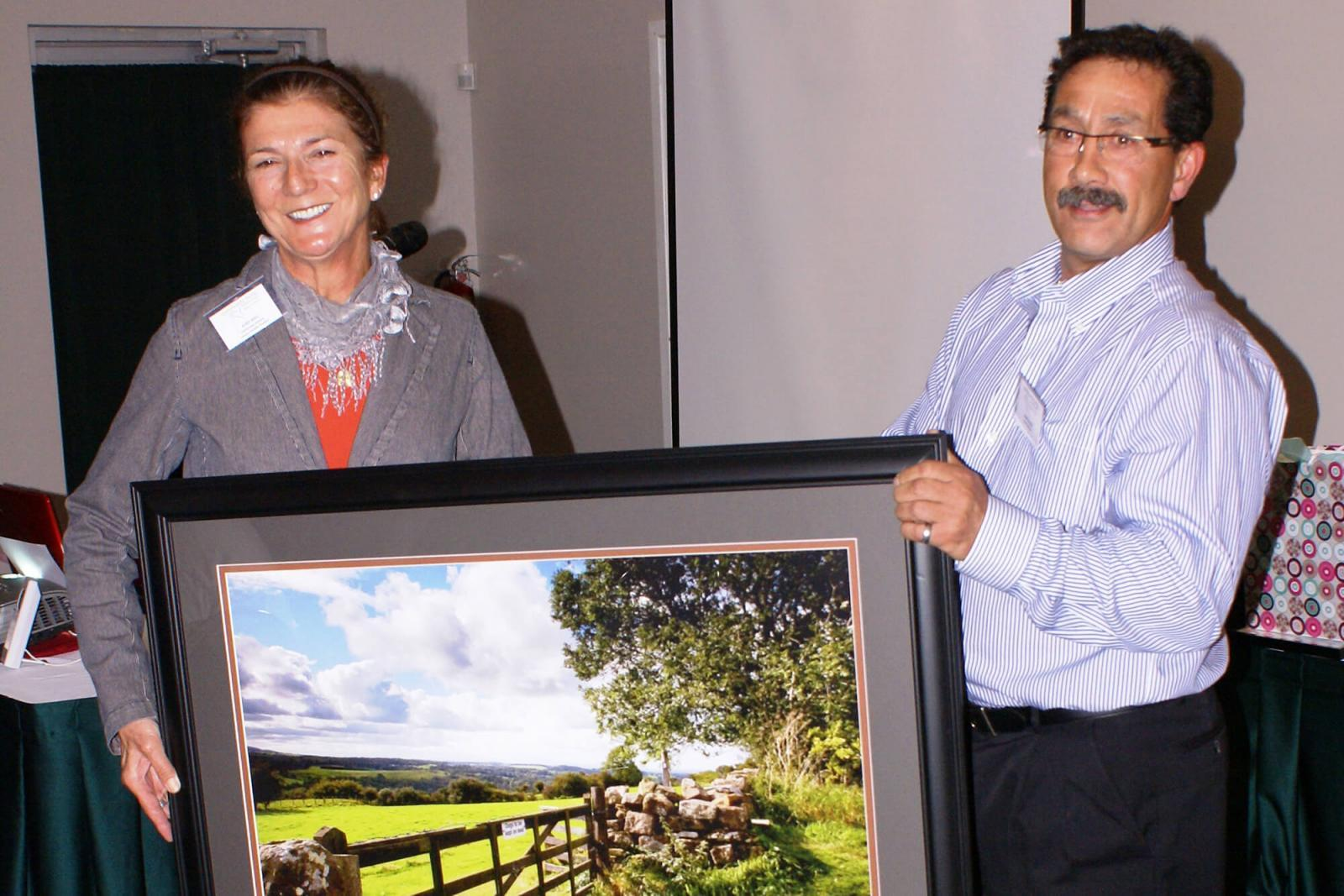 Judy Bell accepts the Community Partnership Award from John Klein, a board member with Community Living Quinte West.