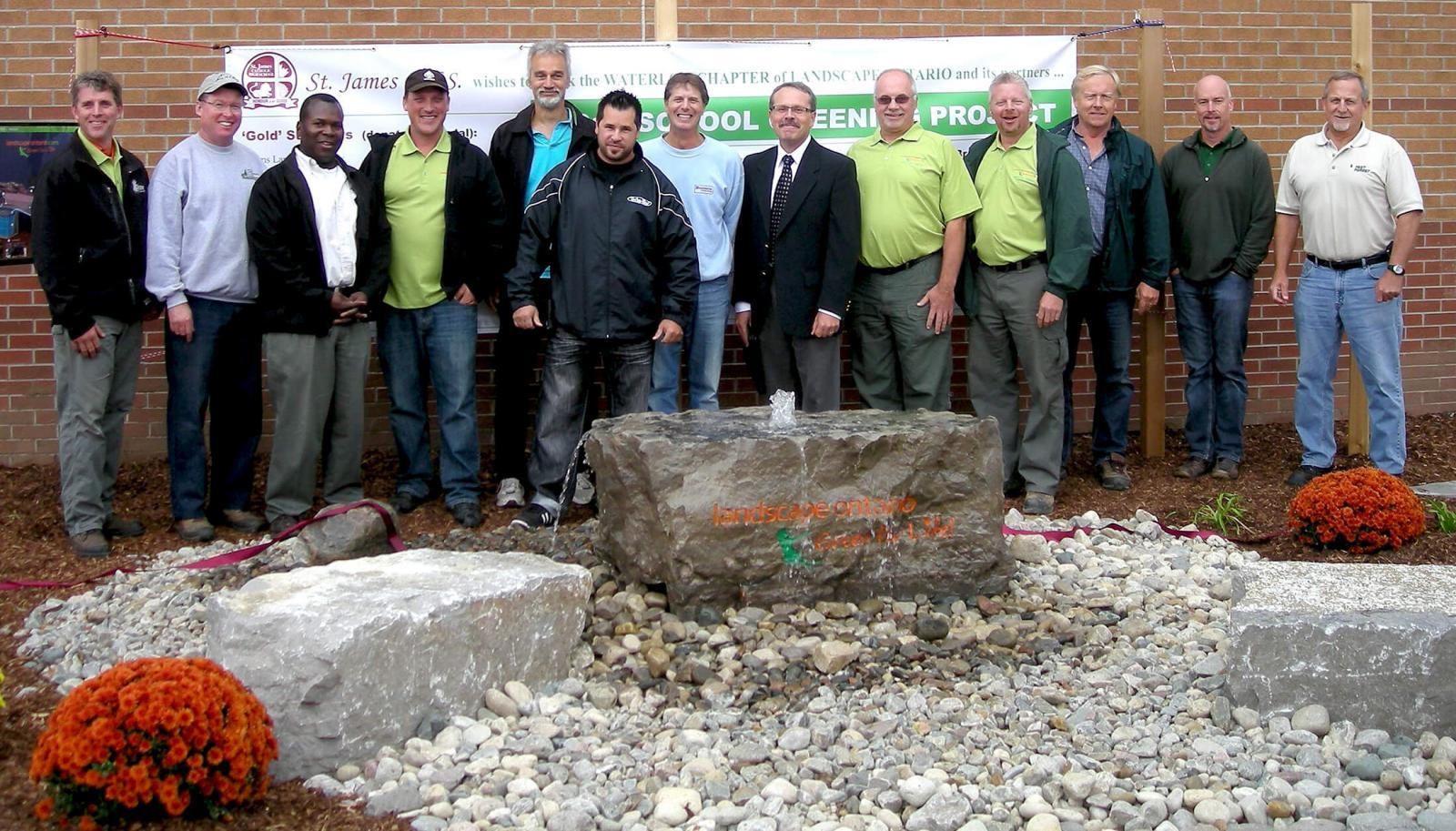 Waterloo Chapter members green another school.
