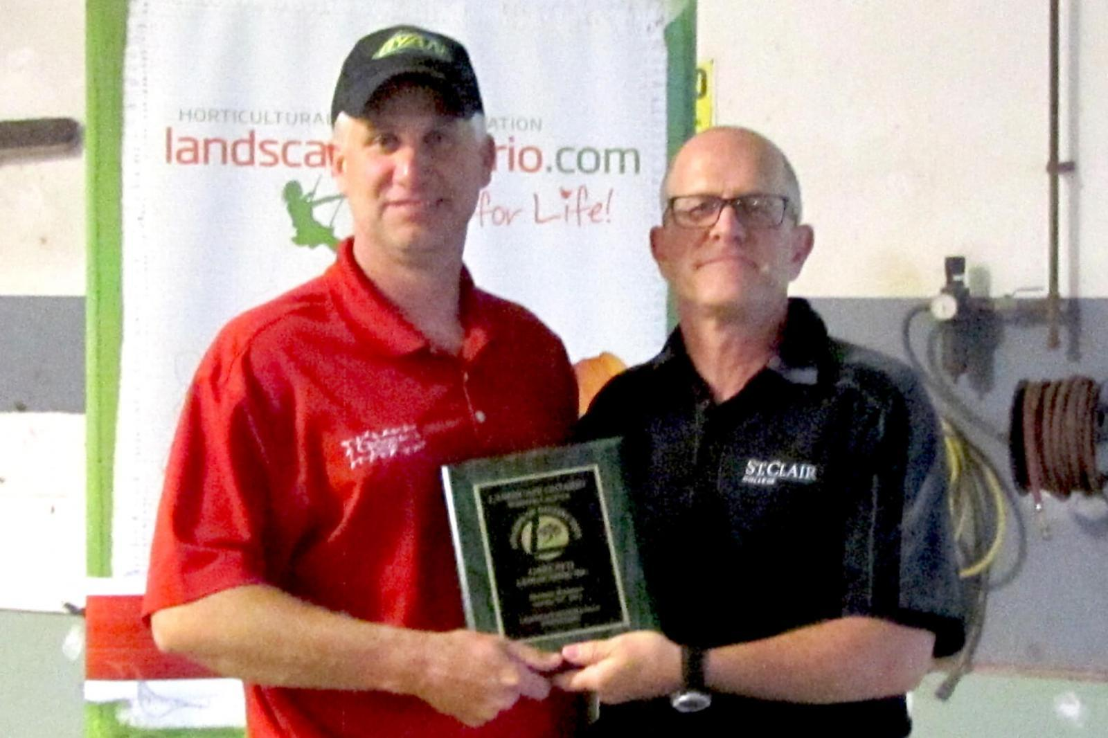 Dan Garlatti accepts one of the three awards his company Garlatti Landscaping won in the Windsor Chapter Awards of Distinction from Jay Terryberry.