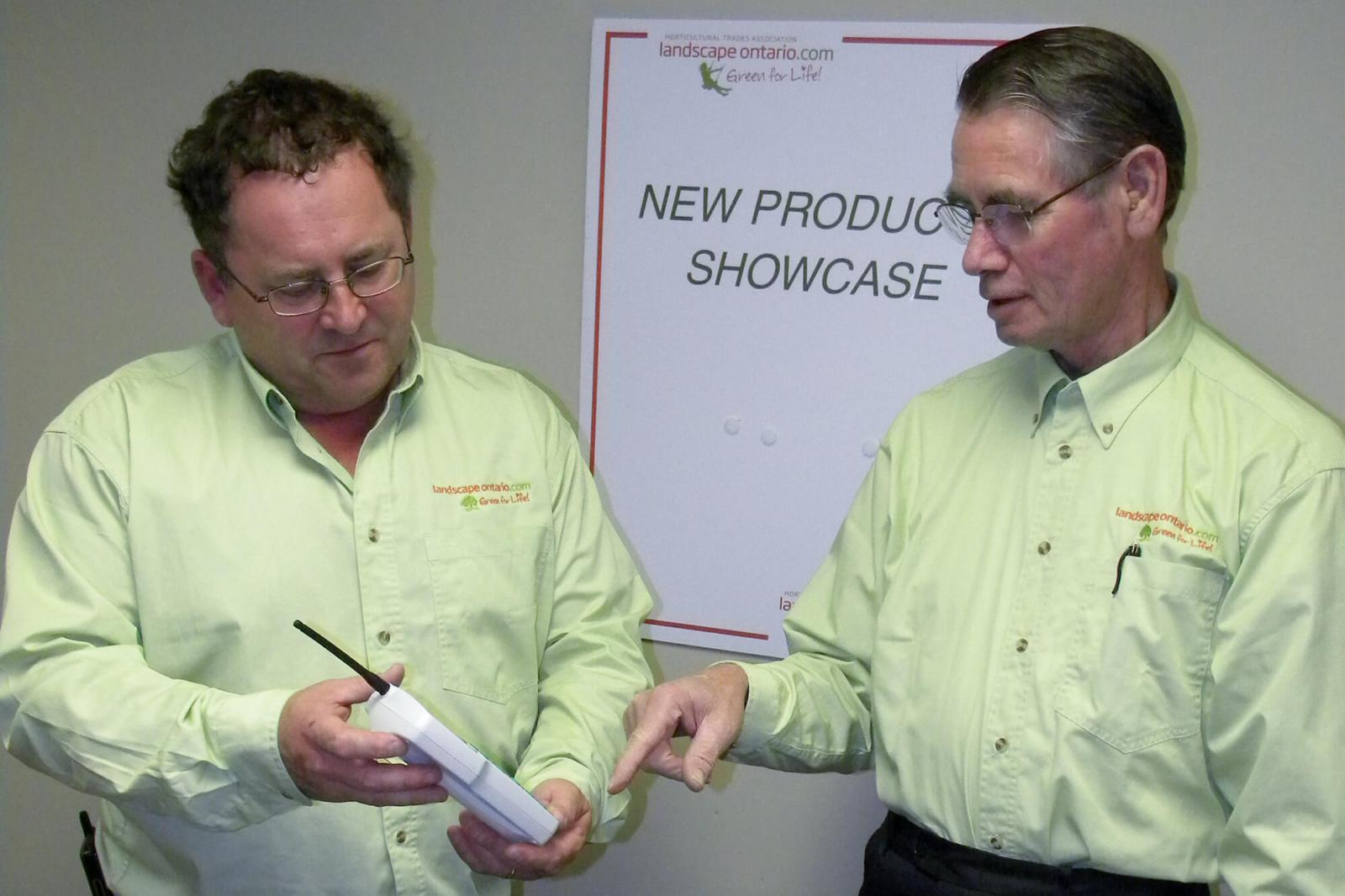 LO show committee members, Terry Childs (left) and Klaas Sikkema look over one of the new products that will be on display at this year's New Product Showcase at Congress 2011.