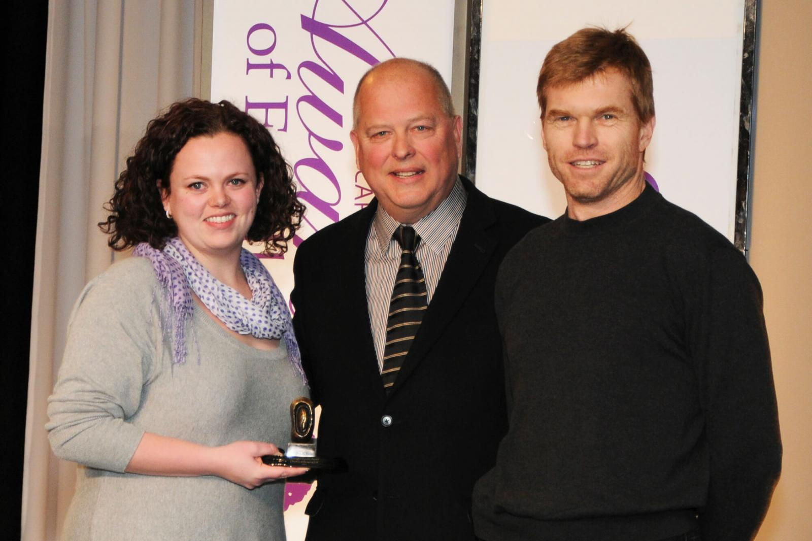 Captions: Karl Stensson (centre) presented the Dunington-Grubb Award to Oriole Landscaping's Sabrina Goettler and Peter Guinane.