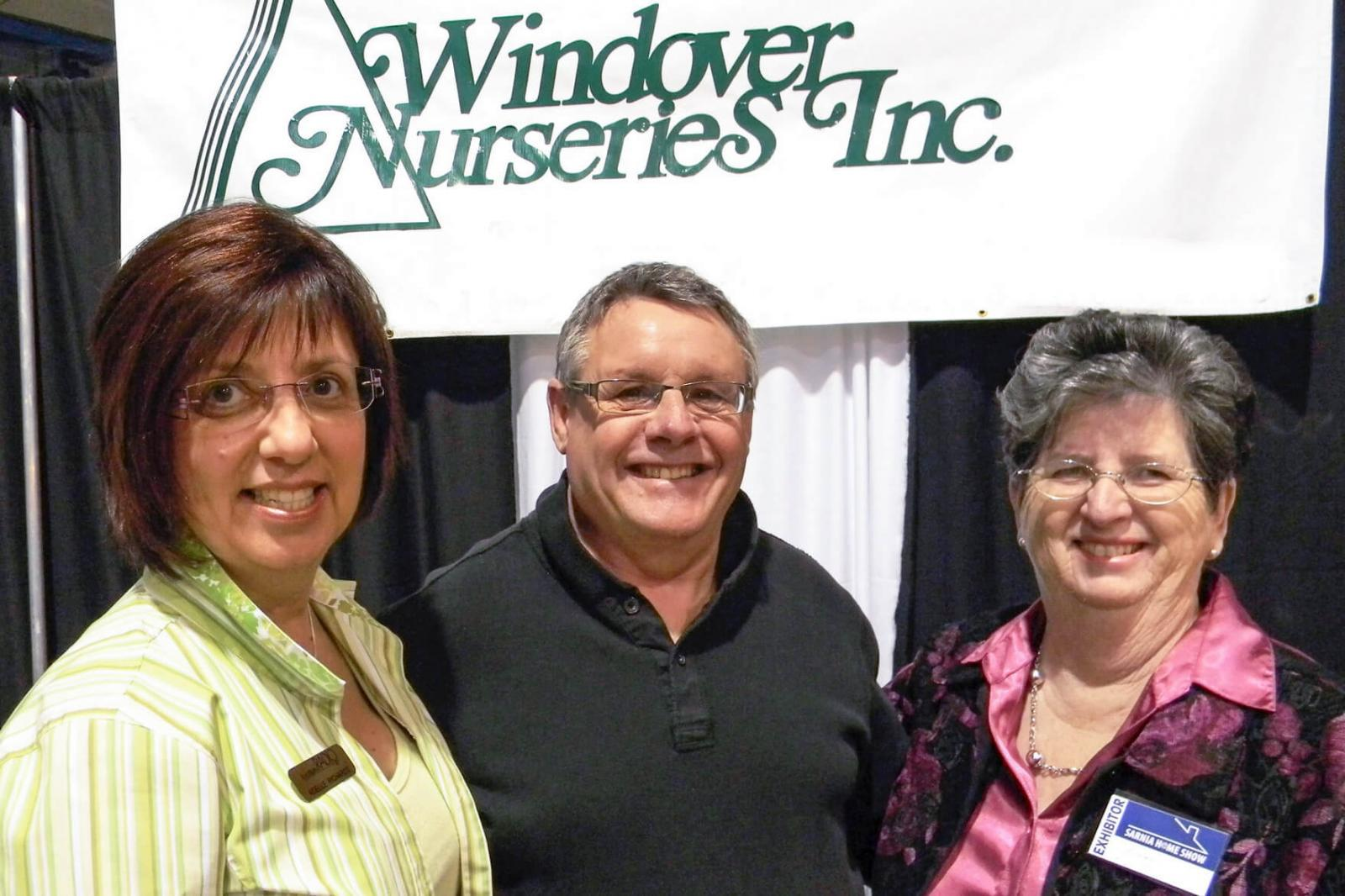 Adele Richards, left, and Jean Windover join Denis Flanagan at the Sarnia Home Show.
