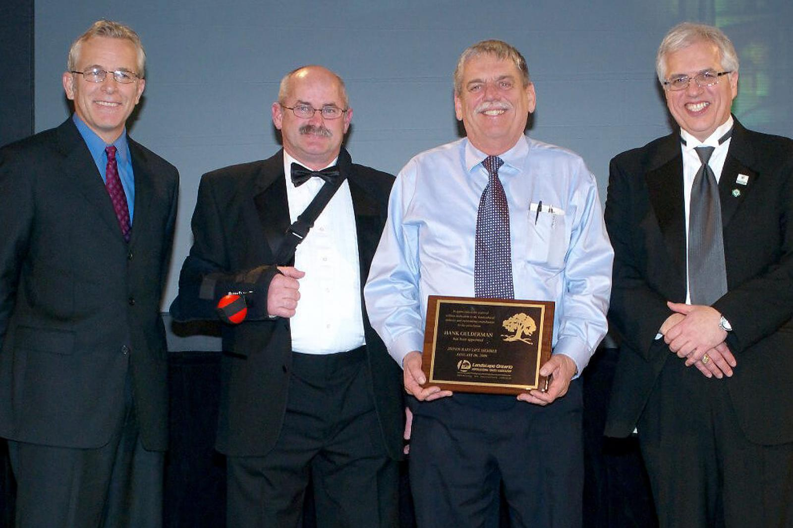 Only nine people in the history of Landscape Ontario have received a Life Membership. Hank Gelderman received the honour in 2009. In photo at the presentation, are from left, Bob Tubby, past president, Bob Adams, president in 2009, Hank Gelderman, and Tony DiGiovanni, executive director.