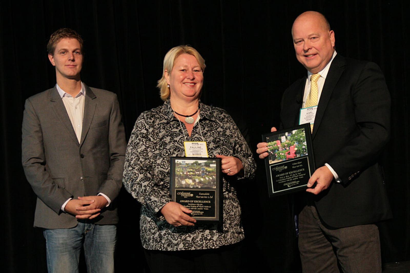 Garden Centre Sector Group chairman Michael Van Dongen presents awards to Pauline Intven-Casier of Canadale Nurseries and Karl Stensson of Sheridan Nurseries.