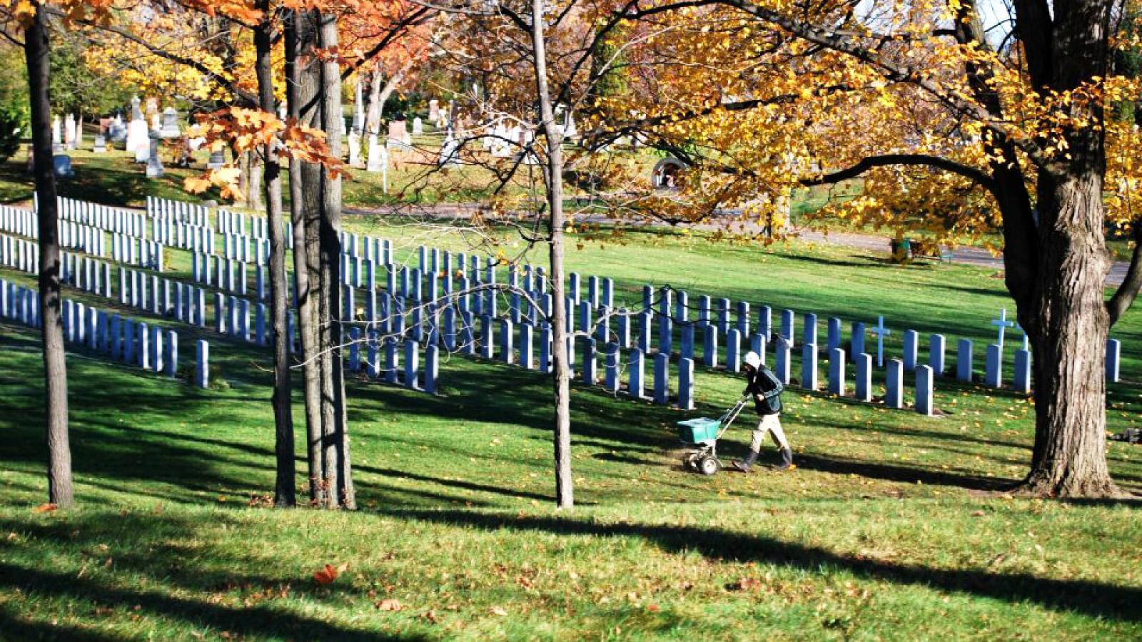 LO volunteers keep the military cemetery beautiful.