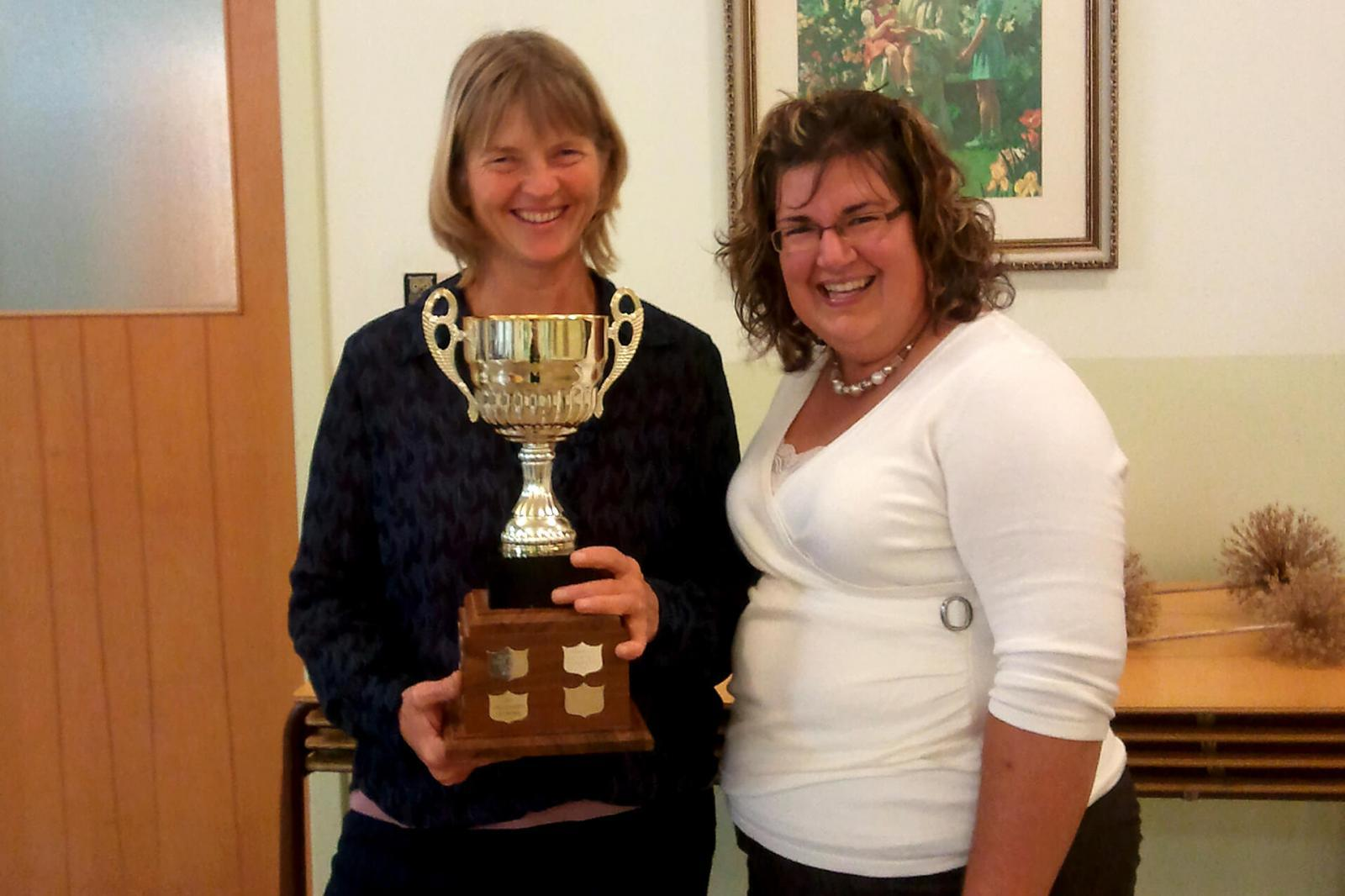 Bonita Glover of The Garden Network, left, accepts the Commercial Beautification Trophy from Lisa Smith of Lisa Purves Garden Design and Consultation, a member of Upper Canada Chapter board of directors.