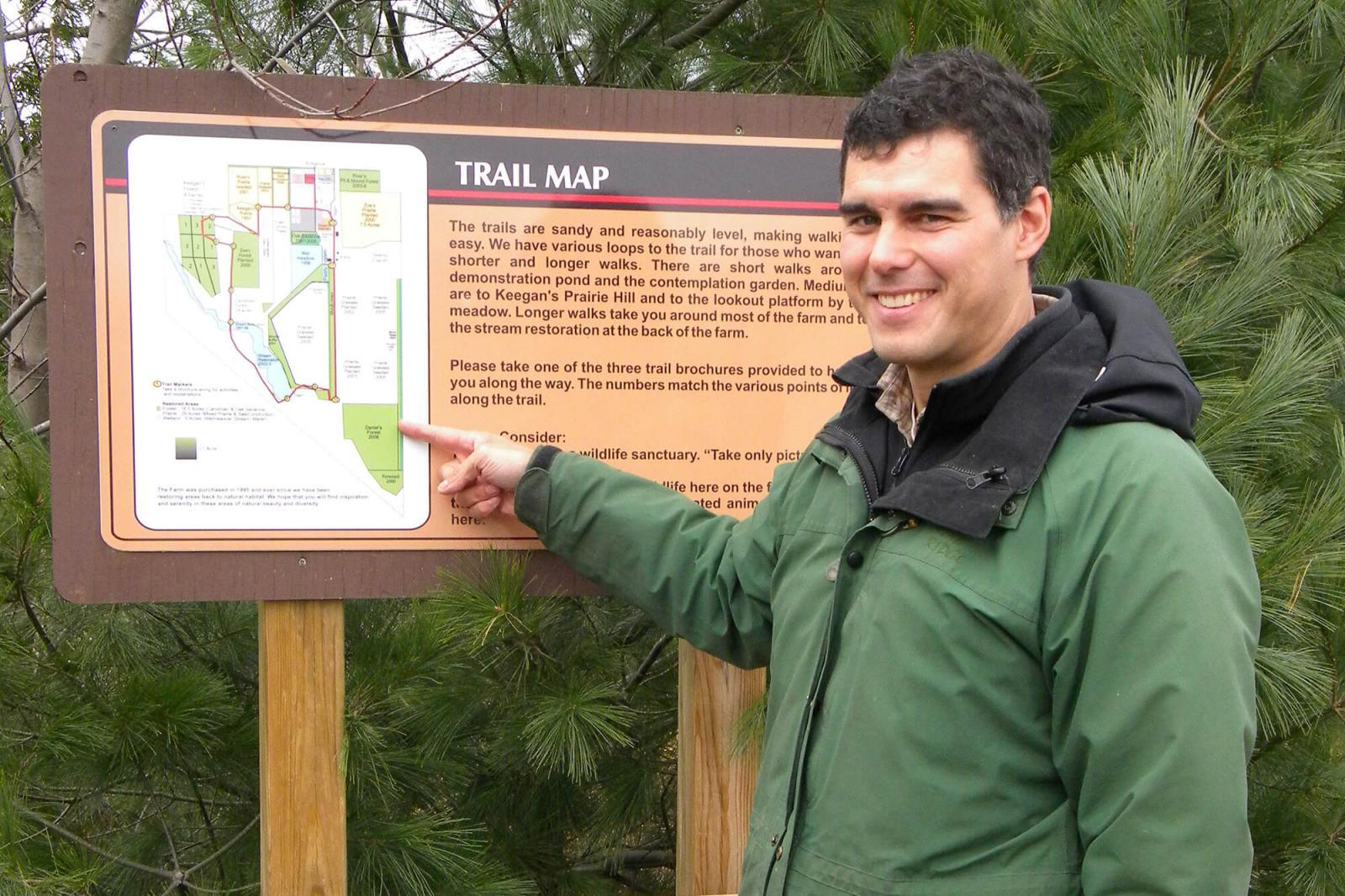 Visitors to the site may take their own tour, or one of the scheduled tour dates. Paul Morris shows map of the trails available on site.