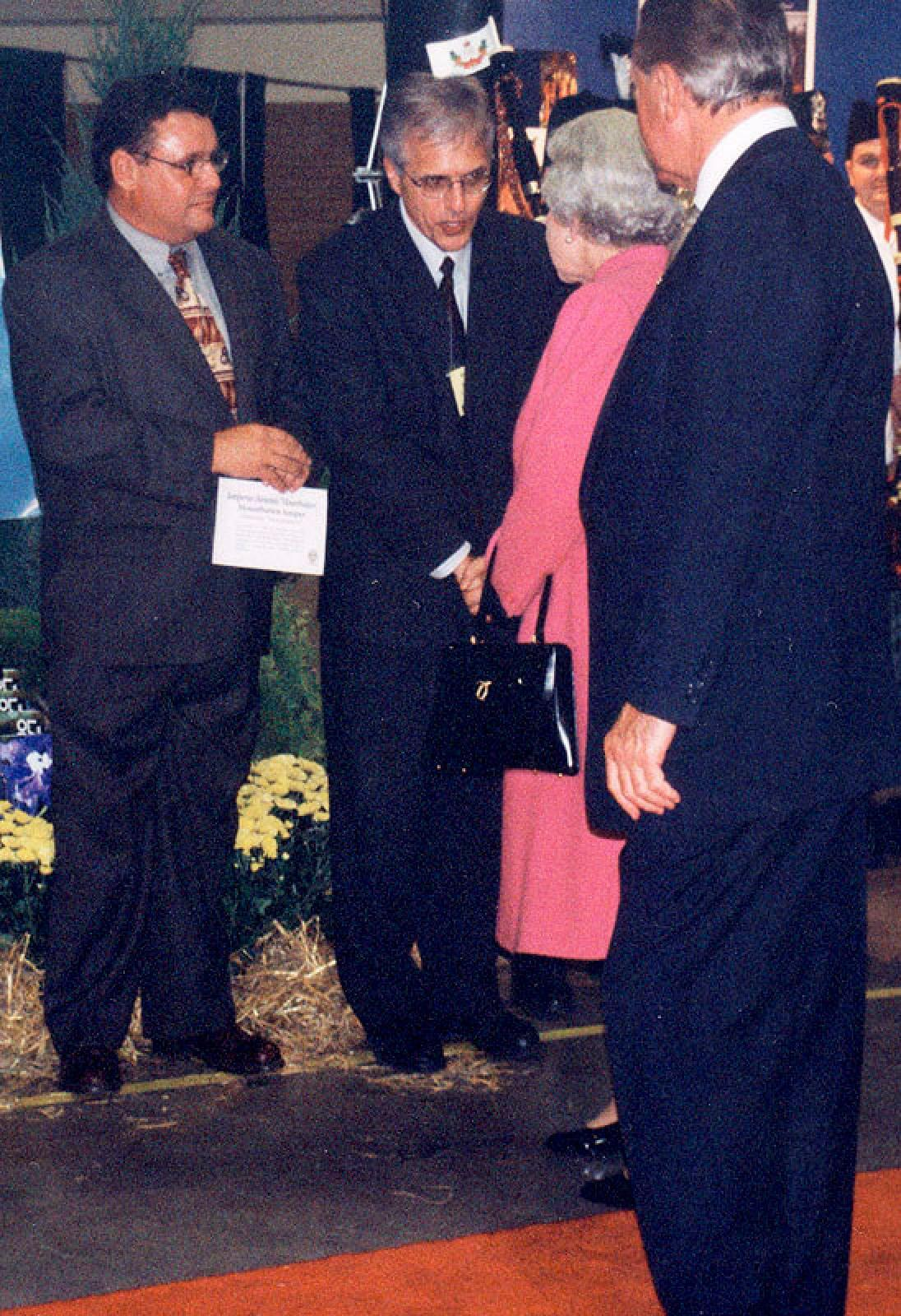 Denis Flanagan (left) and Tony DiGiovanni greeting the Queen.