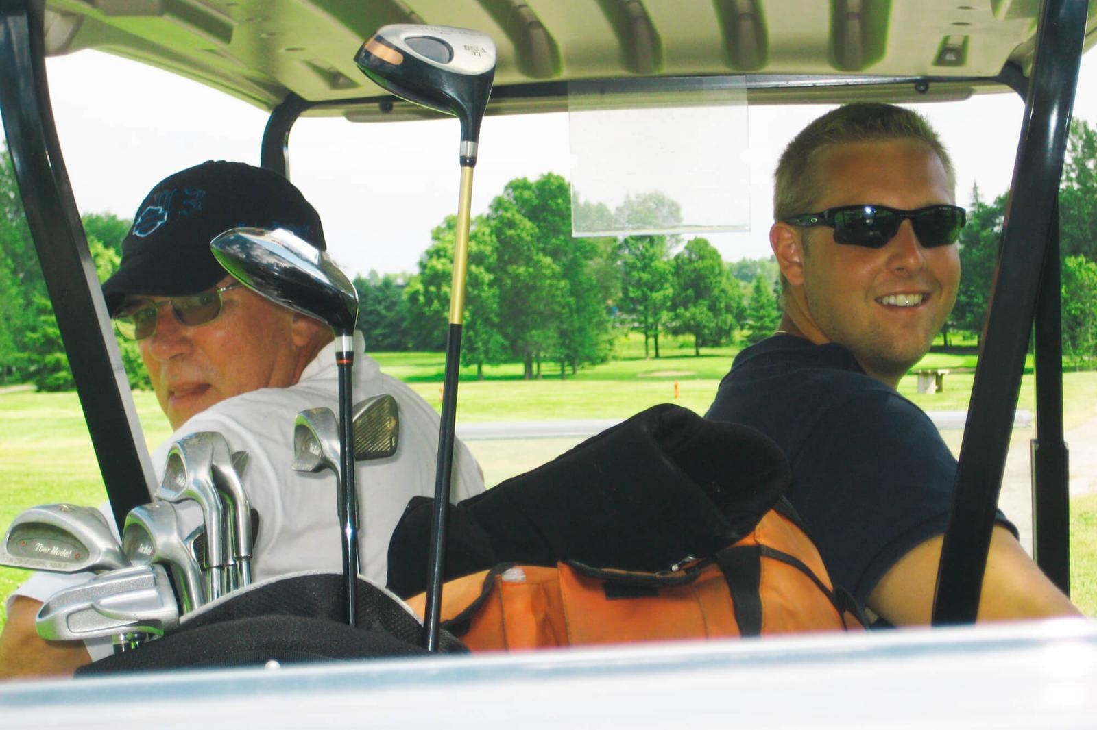 Eric Price, left, and Bill Cross of Thornbusch Landscaping Company enjoyed the day at the Upper Canada Golf Tournament on July 16.