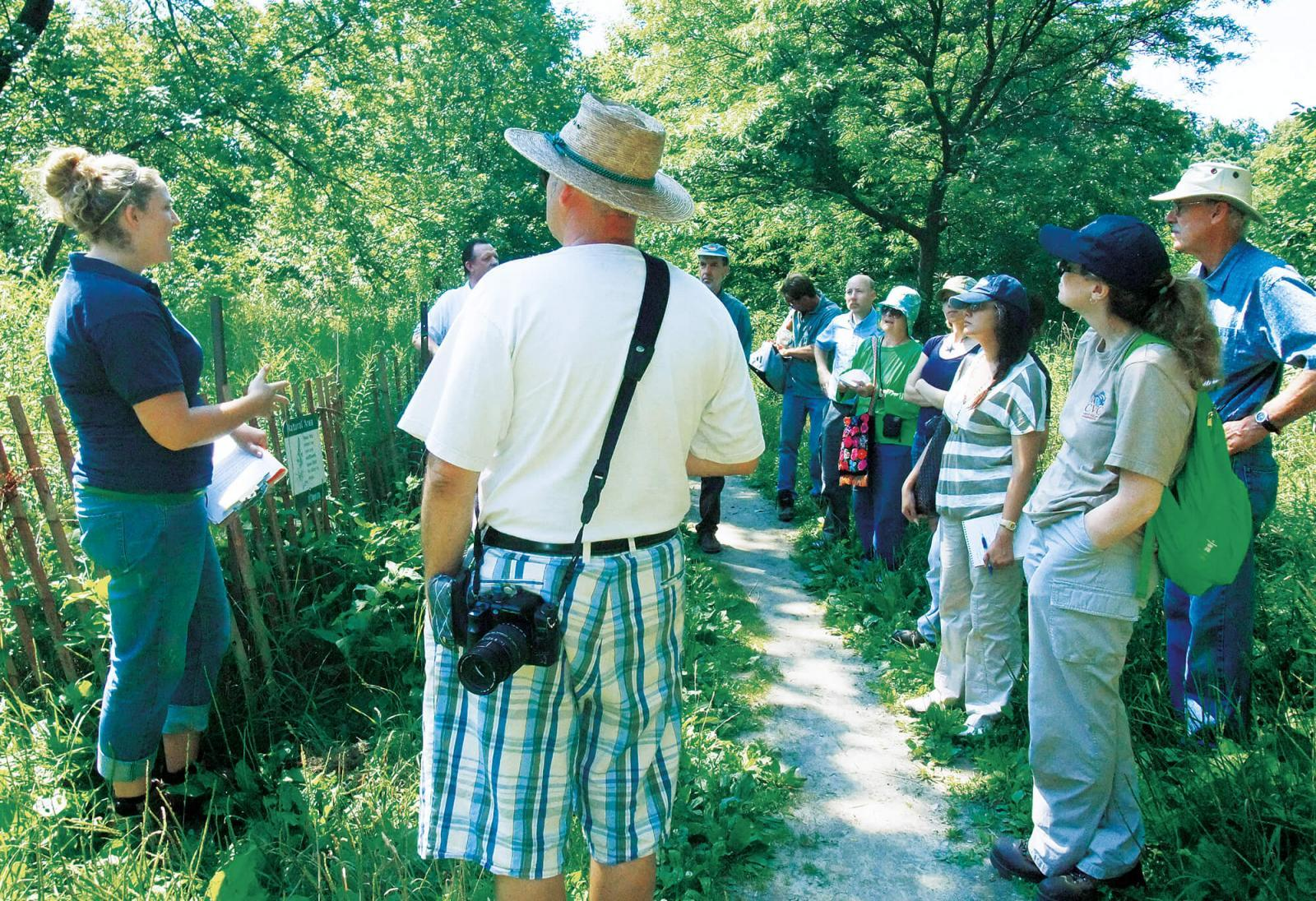 Those taking part in the tour of parks and conservation areas see first-hand the damage caused by invasive plants.