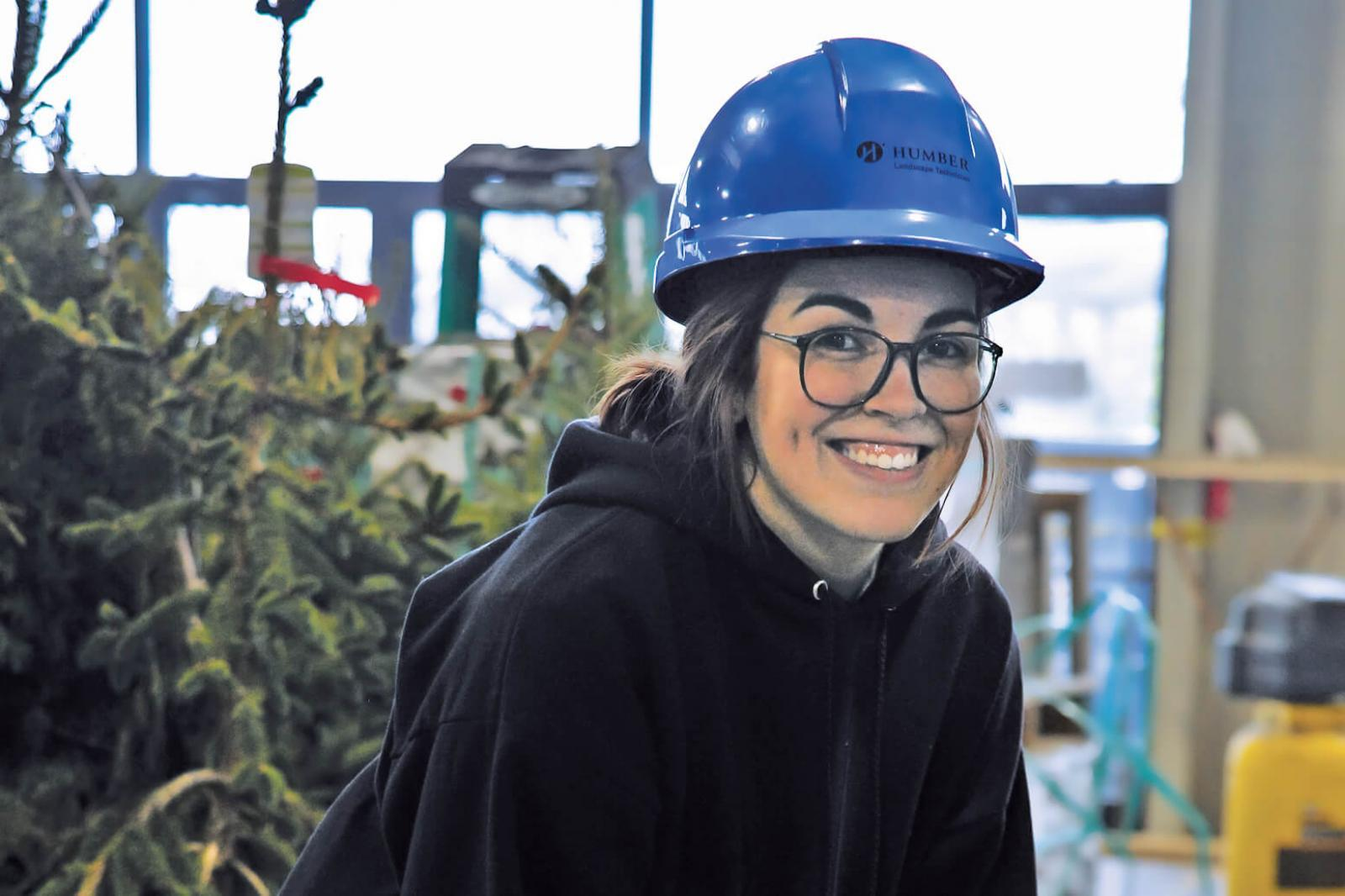 A Humber College student sets a stone at her school's Congress garden build; a foundation for her future career.