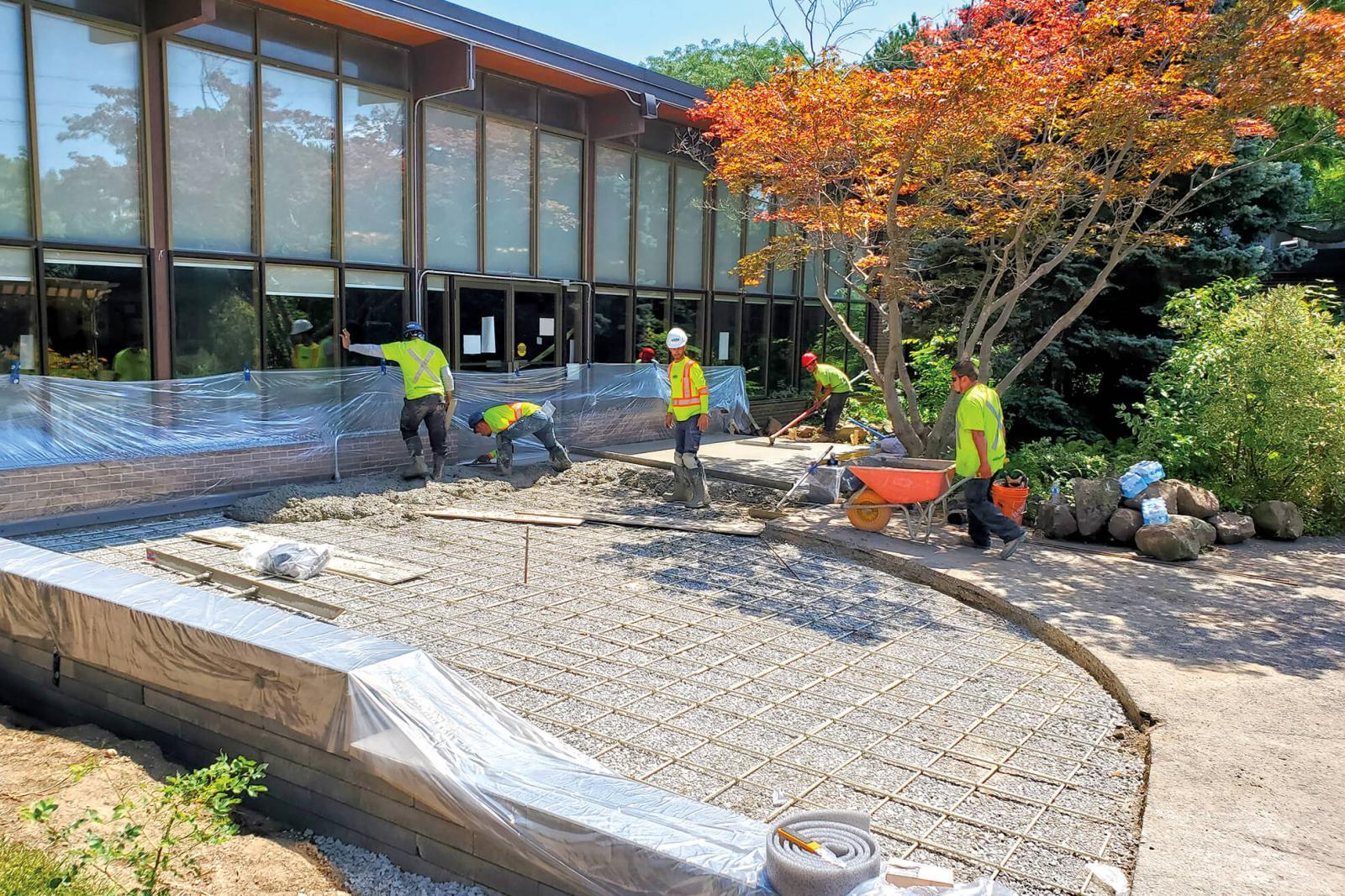 Volunteers work on installing the new outdoor space at Participation House.